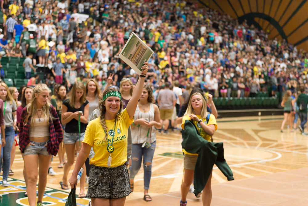 New Students participating in RAMwelcome. Students walking across the floor at Moby Arena
