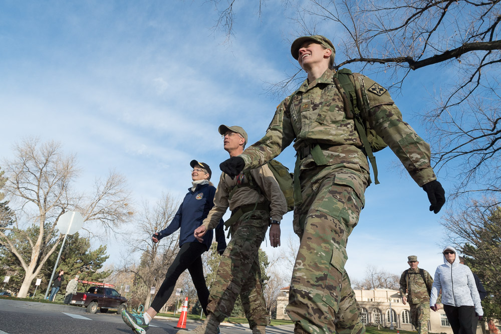 Student wearing Army Uniform and others walking together