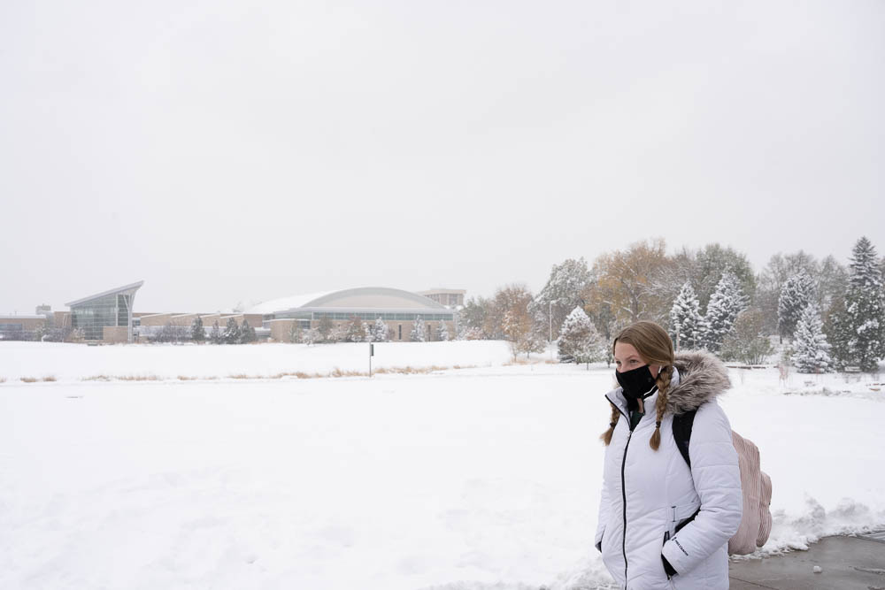 Student walking to class in the snow on CSU's campus.